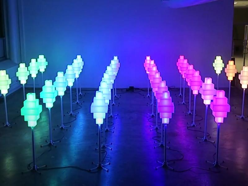 Multi-colored lamps that change color based on human interaction.