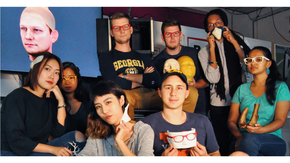 Graduate students pose with their 3D-printed projects.