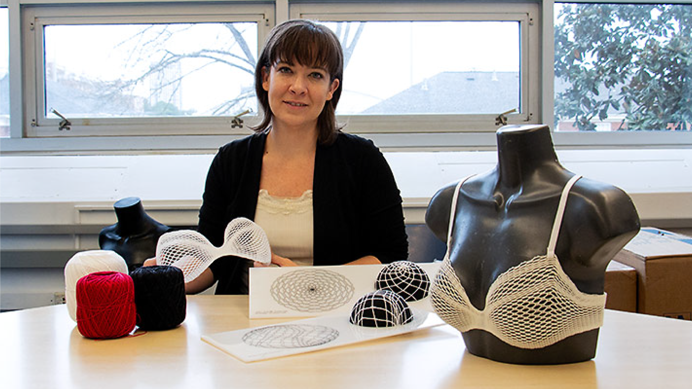 Lisa Marks shows off different phases of the Algorithmic Lace project.