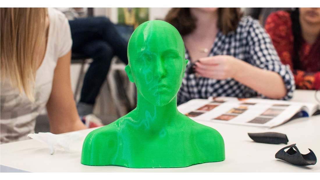 A green, 3D-printed bust of a body scanned student.