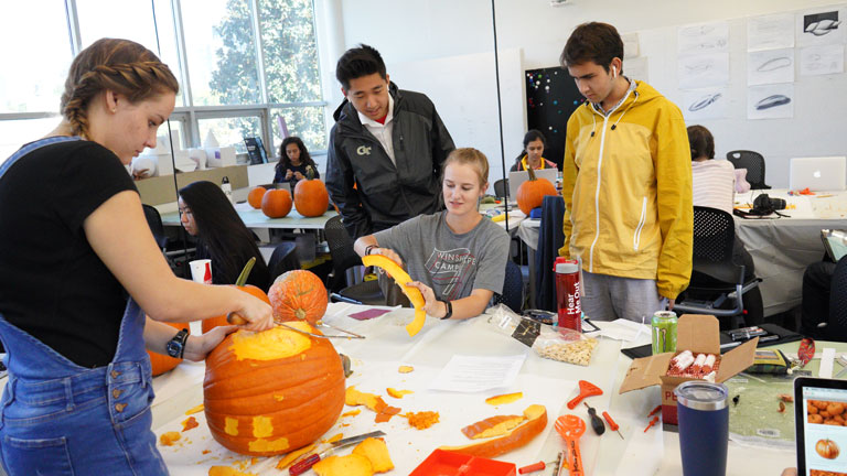 Georgia Tech industrial design students examine pumpkins as a design material for their lesson in Bauhaus designers.