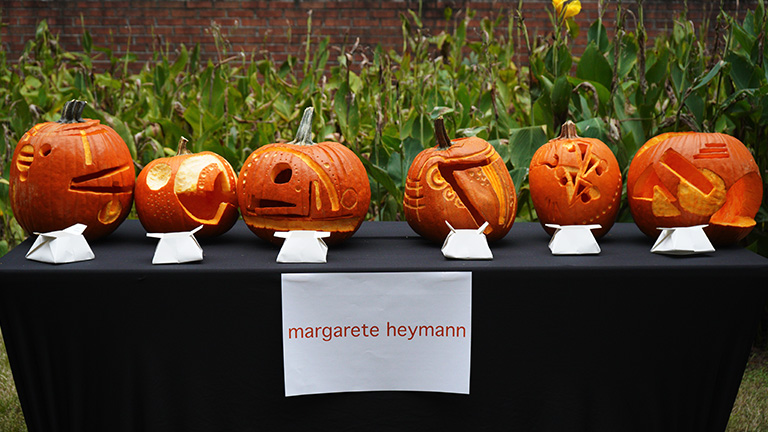 The carved pumpkin designs on this table were inspired by the industrial design work of Margarete Heymann.