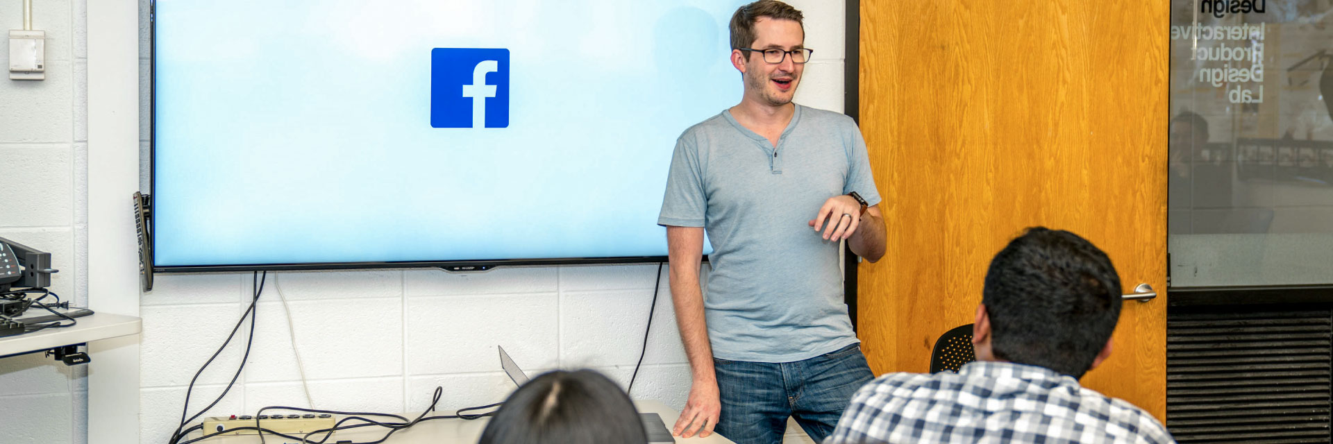 A speaker from Facebook makes a presentation to students.