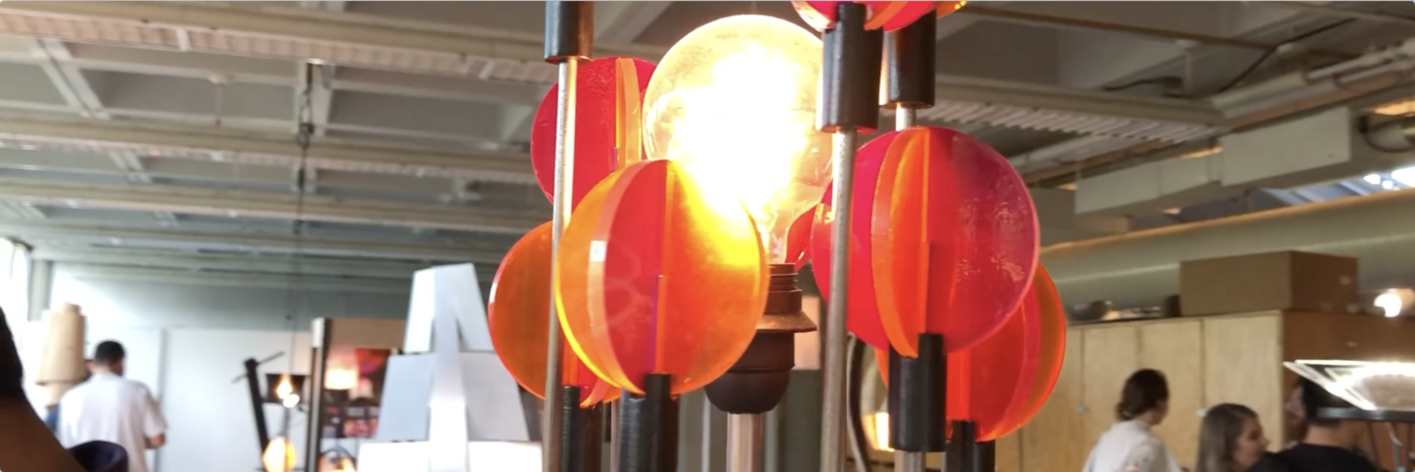 Student lamp design with red and orange accents.